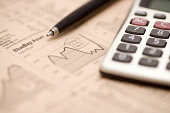 The financial pages of a business newspaper - studying the financial markets, stocks and shares with a pen and calculator. PIC : ALLAN DEVLIN/SCOTTISH VIEWPOINT  Tel: +44 (0) 131 622 7174  Fax: +44 (0... ALLAN DEVLIN/SCOTTISH VIEWPOINT financial times,detail