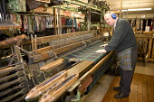 Weaver George Jackson, who has been weaving since the age of 15, demonstrating how to weave tartan cloth on a Hattersley's Standard loom at Moffat Woollen Mill, Moffat, Dumfries and Galloway. PIC : AL... ALLAN DEVLIN/SCOTTISH VIEWPOINT traditional,industry,interior,craft,craftsman
