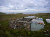 A cat sitting on the outbuildings of a tumbledown croft, or smallholding, near Strathy, Sutherland on Scotland's north coast. This area was one of Europe's most sparsely-populated and suffered many de... C. MCPHERSON/SCOTTISH VIEWPOINT Clearances,Colin McPherson,Great Britain,Scotland,Sutherland,United Kingdom,agriculture,clouds,coast,crofting,farming,hills,history,housing,landscape,mountains,remote,ruins,rural,scenery,tourism,trave