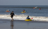 A sping day and a small swell sees these canoeists taking to the water at Pease Bay, Scottish Borders PIC: ANDY BENNETTS/SCOTTISH VIEWPOINT Tel: +44 (0) 131 622 7174   Fax: +44 (0) 131 622 7175 E-Mail... ANDY BENNETTS/SCOTTISH VIEWPOINT Canoes,Sea,Seascape,Sport,Surf,Surf Canoes,Surfing,waves,Type of photograph Sport,Type of photograph Seascape,Other Keywords Canoes,Other Keywords Sea,Other Keywords Surf,Other Keywords Surf Canoes,Ot