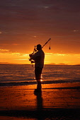 Silhouette of piper in midsummer sunset.  Picture taken on Prestwick Beach in Ayrshire with Arran in the background. PIC: GAVIN MCQUEEN/SCOTTISH VIEWPOINT Tel: +44 (0) 131 622 7174   Fax: +44 (0) 131... GAVIN MCQUEEN/SCOTTISH VIEWPOINT atmospheric,dramatic,piping,bagpipe,bagpipes,bagpiper,piper