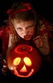 Six year old Emily Bell from Glasgow practices her scary Halloween faces in preparation for trick or treating on Halloween night. PIC: GARRY MCHARG/SCOTTISH VIEWPOINT Tel: +44 (0) 131 622 7174   Fax:... GARRY MCHARG/SCOTTISH VIEWPOINT PUMPKIN