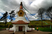 A solitary monk walks clockwise around the newly-built Stupa in the grounds of the Samye Ling Buddhist monastery and temple complex in Dumfriesshire, south-west Scotland. 29/04/04. PIC: COLIN MCPHERSO... RELIGION