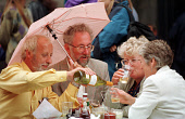 TOURISTS BRAVE THE RAIN ENJOYING AN AL FRESCO GLASS OF WINE AT AN OUTSIDE TABLE IN THE CITY CENTRE OF EDINBURGH. PIC: G.DOAK/SCOTTISH VIEWPOINT Tel: +44 (0) 131 622 7174   Fax: +44 (0) 131 622 7175 E-... CAFE,WET,WEATHER,UMBRELLA,RAINING,DRINKING,DRINK