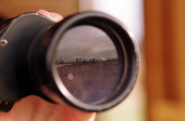 A DETAIL OF ONE OF THE LENS OF A PAIR OF BINOCULARS OF A BIRD WATCHER IN A HIDE OPENED BY SCOTTISH WILDLIFE TRUST AT KINNEIL KERSE MUDFLATS, GRANGEMOUTH, FALKIRK. PIC: G.DOAK/SCOTTISH VIEWPOINT Tel: +... BIRDWATCHER,WATCHING,TWITCHER,REFLECTION,REFINERIES,HOBBY,BIRDWATCHING