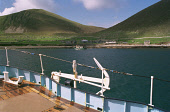THE POPLAR DIVER BOAT APPROACHES VILLAGE BAY ON HIRTA, ONE OF THE ISLANDS IN THE ST. KILDA ARCHIPELAGO - A NATURE RESERVE IN THE HANDS OF THE NATIONAL TRUST FOR SCOTLAND, IN THE ATLANTIC OCEAN, WITH T... ABANDONED,WATER,SUNNY,ISLAND,COAST