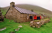 VISITORS ARE INTRODUCED TO THE ISLAND BY THE NATIONAL TRUST WARDEN, ANDY ROBINSON (SECOND LEFT), MAIN STREET, VILLAGE BAY, HIRTA, ONE OF SEVERAL ISLANDS IN THE ST. KILDA ARCHIPELAGO - A NATURE RESERVE... BUILDING,ISLAND,COTTAGE,CONSERVATION
