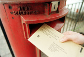 POSTAL VOTING FROM HOME - A MEMBER OF THE PUBLIC PUTS THEIR VOTING FORM INTO A LETTERBOX. PIC: T.NORRIS/SCOTTISH VIEWPOINT Tel: +44 (0) 131 622 7174   Fax: +44 (0) 131 622 7175 E-Mail : info@scottishv... BOX,POST,POLITICS,LETTER,HANDS,ELECTION,COMMUNICATIONS