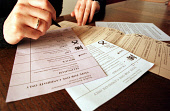 POSTAL VOTING - A MEMBER OF THE PUBLIC MAKES THEIR VOTE AT HOME. PIC: T.NORRIS/SCOTTISH VIEWPOINT Tel: +44 (0) 131 622 7174   Fax: +44 (0) 131 622 7175 E-Mail : info@scottishviewpoint.com This photogr... ELECTION,X,POLITICS,INTERIOR,HANDS