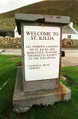 A DETAIL OF THE SIGN REQUESTING VISITORS REORT TO THE WARDEN IN VILLAGE BAY ON HIRTA, ONE OF SEVERAL ISLANDS IN THE ST. KILDA ARCHIPELAGO - A NATURE RESERVE IN THE HANDS OF THE NATIONAL TRUST FOR SCOT... DIRECTIONS,WELCOMING,WELCOME,SIGNAGE,ISLAND,INSTRUCTIONS