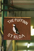 A DETAIL OF THE SIGN FOR THE PUFFINN, VILLAGE BAY, HIRTA, ONE OF SEVERAL ISLANDS IN THE ST. KILDA ARCHIPELAGO - A NATURE RESERVE IN THE HANDS OF THE NATIONAL TRUST FOR SCOTLAND, IN THE ATLANTIC OCEAN.... BUILDING,SIGNAGE,PUB,ISLAND