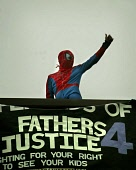 Fathers for Justice hold Protest on top of Labour Party Building  (John Smith House) West Regent Street Glasgow  21 March 05  Pictured   Spiderman  on top of Building. PICTURE-GARY MCHARG/SCOTTISH VIE... Garry F McHarg  FOCAL Scotland DEMO,DEMONSTRATION