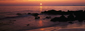 Panorama of a beautiful peaceful sunset over Lower Largo beach in Fife with the sun an orange orb on the horizon and the industrial landscape of Methil in the distance. IAN PATERSON/SCOTTISH VIEWPOINT... IAN PATERSON/SCOTTISHVIEWPOINT ATMOSPHERIC,WATER,SUNNY,SUN,SEA,SCOTLAND,REFLECTIVE,REFLCECTION,OCEAN,GLIMMER