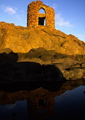Panorama of Ladies Tower and path at Elie on the east neuk coast of Fife with golden sunset colours on the ruin and foreground grasses and the Firth of Forth as a backdrop. IAN PATERSON/SCOTTISH VIEWP... IAN PATERSON/SCOTTISHVIEWPOINT COAST,WATER,SEA,SCOTLAND,RUGGED,ROUGH,REMOTE,OCEAN,HISTORICAL,HISTORIC,GENRIC,DESOLATE,COASTLINE,COASTAL