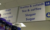 A supermarket sign in English and  Scottish Gaelic for tea, coffee and sugar in Portree on the Isle of Skye in the Inner Hebrides, 5th July 2006. PIC: ALLAN MILLIGAN/SCOTTISH VIEWPOINT  Tel: +44 (0) 1... Allan Milligan POLITICS,SIGNAGE,SCOTLAND
