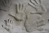 Hand prints in the cement at the Swallow Theatre near Wigtown in the Machars of Galloway Scotland UK PIC: ALLAN DEVLIN/SCOTTISH VIEWPOINT Tel: +44 (0) 131 622 7174   Fax: +44 (0) 131 622 7175 E-Mail :... hand,hands,print,prints,small,big,large,man,woman,child,children,size,palm,finger,fingers,cement,family,impression,character,characters,young,old,swallow,theatre,wigtown,scottish,scotland,uk,machars,o