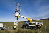 Hydro Electric ELECTRICITY ENERGY Workmen working on electricity wire pole power lines Orkney PIC: DOUG HOUGHTON/SCOTTISH VIEWPOINT Tel: +44 (0) 131 622 7174   Fax: +44 (0) 131 622 7175 E-Mail : info@... D HOUGHTON/SCOTTISHVIEWPOINT workmen,electric,pole,safety,cradle,crane,repair,scotland,transmission,high,tension,cables,connect,national,grid,tower,supports,main,powerlines,supply,service,public,utility,industrial,industry,networ