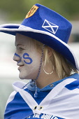 Female football soccer fan in her teams colours blue and white with a cowboy hat on face painted and a flag Scotland UK PIC: ALLAN DEVLIN/SCOTTISH VIEWPOINT Tel: +44 (0) 131 622 7174   Fax: +44 (0) 13... ALLAN DEVLIN/SCOTTISHVIEWPOINT scottish,cup,final,2008,football,soccer,scotland,queen,of,the,south,dumfries,doonhamers,fan,supporter,support,party,time,queens,qos,q.o.s,female,girl,face,painted,blue,white,team,colours,flag,hat,cowb