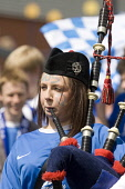 Scottish female football fan playing the bagpipes busking at the Scottish Cup Final at Hampden Park Glasgow Scotland UK PIC: ALLAN DEVLIN/SCOTTISH VIEWPOINT Tel: +44 (0) 131 622 7174   Fax: +44 (0) 13... ALLAN DEVLIN/SCOTTISHVIEWPOINT scottish,cup,final,2008,football,soccer,scotland,queen,of,the,south,glasgow,rangers,dumfries,doonhamers,fan,crowd,supporter,support,party,time,queens,qos,bagpipes,piper,female,face,paint,excited,flags