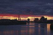 Sunset over Govan, Glasgow.  PIC: KEITH FERGUS/SCOTTISH VIEWPOINT?Tel: +44 (0) 131 622 7174  ?Fax: +44 (0) 131 622 7175?E-Mail : info@scottishviewpoint.com?This photograph can not be used without prio... KEITH FERGUS/SCOTTISH VIEWPOINT water,industry,crane,cranes,shipbuilding,atmospheric,river clyde,reflection
