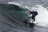 Surfing at Brimms Ness, Caithness District, Highland. PIC: A. BENNETTS/SCOTTISH VIEWPOINT Tel: +44 (0) 131 622 7174   Fax: +44 (0) 131 622 7175 E-Mail : info@scottishviewpoint.com This photograph can... A. BENNETTS/SCOTTISH VIEWPOINT Coast,Highlands,Sea,Seascape,Sport,Surf,Surf competition,Surfboard,Surfing,Water,Waves,Places-Edinburgh,Type of photograph-Townscape,Other Keywords-Canongate Churchyard,Other Keywords-Edinburgh,Other