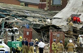 McHarg Photo. Search and Rescue squads along with emergency services at the Maryhill factory explosion site (day two) Glasgow Scotland   pictured    search and rescue workers at scene   please make al... Garry F McHarg   Focal Scotland