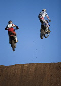 Competitors fly off a jump at the Duns motocross track, Scottish Borders.  Pic: Andy Bennetts/Scottish Viewpoint Tel: +44 (0) 131 622 7174 Fax: +44 (0) 131 622 7175 E-mail: info@scottishviewpoint.com... PUBLIC, NMR Motocross,Motocross Racing,Mud,Motorbike,Motorbike Racing,Motorcycle,Motorcycle Racing,Motorsport,Racing,Rain,Scotland,Sport,Water,Wet,Places East Lothian,Places North Berwick,Places Lowlands,Places S