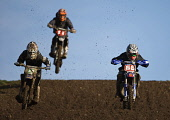 Competitors race for the lead at the Duns motocross track, Scottish Borders. Pic: Andy Bennetts/Scottish Viewpoint Tel: +44 (0) 131 622 7174 Fax: +44 (0) 131 622 7175 E-mail: info@scottishviewpoint.co... PUBLIC, NMR Motocross,Motocross Racing,Mud,Motorbike,Motorbike Racing,Motorcycle,Motorcycle Racing,Motorsport,Racing,Scotland,Sport,Places|East Lothian,Places|North Berwick,Places|Lowlands,Places|Scotland,Other K