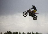 A competitor flies off a jump at the Duns motocross track, Scottish Borders. Pic: Andy Bennetts/Scottish Viewpoint Tel: +44 (0) 131 622 7174 Fax: +44 (0) 131 622 7175 E-mail: info@scottishviewpoint.co... PUBLIC, NMR Motocross,Motocross Racing,Mud,Motorbike,Motorbike Racing,Motorcycle,Motorcycle Racing,Motorsport,Racing,Rain,Scotland,Sport,Water,Wet,Places East Lothian,Places North Berwick,Places Lowlands,Places S