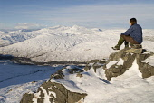 FEMALE HILLWALKER AND A SNOW COVERED WINTER VIEW OF GLEN FALLOCH AND THE TWO MUNROS OF BEN OSS AND BEINN DUBHCHRAIG FROM SRON GHARBH ON AN CAISTEAL (MUNRO), NEAR CRIANLARICH, STIRLING DISTRICT, SCOTLAND, WINTER. PIC: R.CLARKSON/SCOTTISH VIEWPOINT Tel: +44 (0) 131 622 7174   Fax: +44 (0) 131 622 7175 E-Mail : info@scottishviewpoint.com This photograph cannot be used without prior permission from Scottish Viewpoint. PUBLIC, MR horizontal,beautiful,calm,dramatic,grandeur,Highlands,hills,hillwalker,hillwalking,inspiring,isolation,landscape,lonely,majestic,mountain,mountains,peaceful,remote,scenic,Scottish Highlands,uplands,walker,woodland,snow,snowfall,sunny,blue,white,winter,blue sky