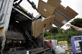 CARDBOARD BOXES BEING THROWN INTO THE BACK OF A REFUSE LORRY. PIC: GARY DOAK/SCOTTISH VIEWPOINT Tel: +44 (0) 131 622 7174   Fax: +44 (0) 131 622 7175 E-Mail : info@scottishviewpoint.com This photograp... PUBLIC RUBBISH,BINMAN,BIN LORRY