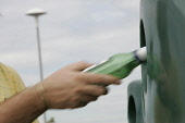 A BOTTLE BEING PLACED IN A RECYCLING BIN. PIC: GARY DOAK/SCOTTISH VIEWPOINT Tel: +44 (0) 131 622 7174   Fax: +44 (0) 131 622 7175 E-Mail : info@scottishviewpoint.com This photograph can not be used wi... PUBLIC MR ENVIRONMENT,RECYCLING,GREEN,GLASS,BOTTLE BANK