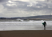 A surfer at Peffer Sands, East Lothian.  PIC: ANDY BENNETTS/SCOTTISH VIEWPOINT  Tel: +44 (0) 131 622 7174  Fax: +44 (0) 131 622 7175  E-Mail: info@scottishviewpoint.com  Web: www.scottishviewpoint.com... ANDY BENNETTS/SCOTTISH VIEWPOINT Beach,Coast,Coastline,Sand,Scotland,Sea,Seascape,Sport,Surf,Surfing,Swell,Water,Water sport,Waves,Places|East Lothian,Places|North Berwick,Places|Lowlands,Places|Scotland,Other Keywords|East Lothian,O