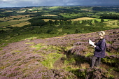Taking in the view from the Eildon Hills, Scottish Borders.  PIC: ANDY BENNETTS/SCOTTISH VIEWPOINT  Tel: +44 (0) 131 622 7174  Fax: +44 (0) 131 622 7175  E-Mail: info@scottishviewpoint.com  Web: www.s... ANDY BENNETTS/SCOTTISH VIEWPOINT Heather,Hills,Landscape,Lowlands,Melrose,walking,walker,map,activity,Places|East Lothian,Places|North Berwick,Places|Lowlands,Places|Scotland,Other Keywords|East Lothian,Other Keywords|Viewpoint,Type