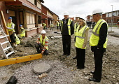 Glasgow East Campaign trail Labour candidate Margaret Curran MSP visits building site in Lochdochart Road Easterhouse Pictured........Margaret Curan MSP with Stephen Purcell (labour council leader) me... Public, NMR curran,margaret,labour,campaign,easterhouse,stephen,purcell