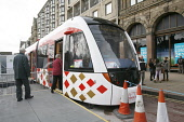 A tram on Princes Street in Edinburgh in preparation for the introduction of trams to the city. 27 Mar 2009. Pic: Tina Norris / Scottish Viewpoint Tel: +44 (0) 131 622 7174 Fax: +44 (0) 131 622 7175 E... Public SPRING,TRAFFIC,DEVELOPMENT,TRANSPORT,PROJECT,TRAMWORKS,ROADWORKS,CLOSURE,JENNERS