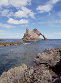 Bow Fiddle Rock PORTNOCKIE MORAY Coastal rock arch  Pic: Doug Houghton / Scottish Viewpoint Tel: +44 (0) 131 622 7174 Fax: +44 (0) 131 622 7175 E-Mail: info@scottishviewpoint.com Web: www.scottishview... Public moray,portnockie,bow,fiddle,rock,arch,outcrop,scotland,scottish,littoral,landmark,sea,horizon,countryside,country,side,nature,natural,coast,coastal,marine,outside,outdoors,seas,stacks,isolated,pinnacl