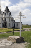 JOHN O GROATS CAITHNESS North of Scotland signpost John OGroats Inn white walled hotel  Pic: Doug Houghton / Scottish Viewpoint Tel: +44 (0) 131 622 7174 Fax: +44 (0) 131 622 7175 E-Mail: info@scottis... Public caithness,john,o,groats,signpost,milepost,scotland,scottish,road,sign,post,roadsign,information,inform,mile,direct,directs,directions,directing,signs,travel,accommodation,hotel,hotels,hostelry,inn,tou