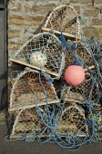 DUNBEATH CAITHNESS Creel crab lobster pots pink boat buoy floats  Pic: Doug Houghton / Scottish Viewpoint Tel: +44 (0) 131 622 7174 Fax: +44 (0) 131 622 7175 E-Mail: info@scottishviewpoint.com Web: ww... Public creel,crab,lobster,pots,floats,scottish,fishing,scotland,outdoors,fixing,navigation,markers,fishnet,net,fishermans,tools,equipment,fishingboat,storage,storing,store,stored,local,fishery,industry,marit