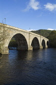 River Tay DUNKELD PERTHSHIRE Stone arched bridge built by Thomas Telford  Pic: Doug Houghton / Scottish Viewpoint Tel: +44 (0) 131 622 7174 Fax: +44 (0) 131 622 7175 E-Mail: info@scottishviewpoint.com... Public perthshire,dunkeld,river,tay,scotland,scottish,transport,travel,stone,construction,spans,spanning,fresh,flowing,flow,water,crossing,span,riverside,side,road,bridge,roadbridge,architecture,history,hist
