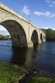 River Tay DUNKELD PERTHSHIRE Stone arched bridge built by Thomas Telford  Pic: Doug Houghton / Scottish Viewpoint Tel: +44 (0) 131 622 7174 Fax: +44 (0) 131 622 7175 E-Mail: info@scottishviewpoint.com... Public perthshire,dunkeld,river,tay,stone,arched,bridge,scotland,scottish,transport,construction,spans,spanning,fresh,flowing,flow,water,crossing,span,riverside,side,travel,road,roadbridge,architecture,histo