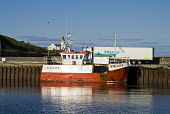SCRABSTER CAITHNESS Fishing boat trawler and refridgeration lorry in Scrabster Harbour  Pic: Doug Houghton / Scottish Viewpoint Tel: +44 (0) 131 622 7174 Fax: +44 (0) 131 622 7175 E-Mail: info@scottis... Public caithness,scrabster,fish,boat,harbour,trawlers,port,scotland,scottish,fishingboat,fishboat,fishing,pier,quay,quayside,docked,dockside,sea,seaport,alongside,along,side,moored,berthed,community,coastal,