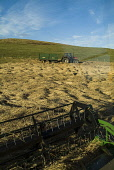 HARVESTING FARMING Combine harvester cutters harvesting barley and tractor trailer  Pic: Doug Houghton / Scottish Viewpoint Tel: +44 (0) 131 622 7174 Fax: +44 (0) 131 622 7175 E-Mail: info@scottishvie... Public farming,combine,harvester,barley,cutters,tractor,scotland,scottish,machine,machinery,mechanised,mechanized,motorised,gathering,cuts,agronomy,farmland,field,farm,land,reap,outdoors,outside,countrylife,