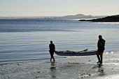 Two woman on beach carrying canoe to waters edge Kayak WATERSPORT SPORT  Pic: Doug Houghton / Scottish Viewpoint Tel: +44 (0) 131 622 7174 Fax: +44 (0) 131 622 7175 E-Mail: info@scottishviewpoint.com... Public sport,watersport,kayak,kayaking,canoe,carrying,seaside,sea,side,beach,sand,resort,canoing,canoes,kaiak,kyak,kyack,kayaks,kaiaks,kyaks,kyacks,kaiaking,kyaking,kyacking,water,watersports,sports,people,w