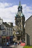 Town hall clock tower and people in High Street  DUNFERMLINE FIFE  Pic: Doug Houghton / Scottish Viewpoint Tel: +44 (0) 131 622 7174 Fax: +44 (0) 131 622 7175 E-Mail: info@scottishviewpoint.com Web: w... Public fife,dunfermline,scotland,scottish,people,women,ladies,females,girls,street,streetscape,streetscene,scene,town,hall,public,civic,building,council,official,architectural,architecture,built,woman,lady,f