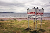 Warning signs on the beach next to the lighthouse at Chanonry Point, overlooking the Moray Firth in the Highlands of Scotland. Pic: Allan Coutts / Scottish Viewpoint Tel: +44 (0) 131 622 7174 Fax: +44... Public, NMR Chanonry Point,lighthouse,Moray Firth,Inverness,Highlands,Higland,Council,Ross,Cromarty,coast,coastal,sea,tide,currents,water,danger,swimming,bathing,dangerous,warning,beach,tourism,tourist,vacation,s