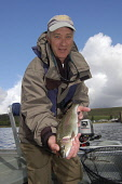 AN ANGLER SHOWS OF HIS CATCH OF TROUT AT CARRON VALLEY RESERVOIR, CENTRAL SCOTLAND. PIC: Scott Whitelaw / Scottish Viewpoint TEL: +44 (0) 131 622 7174 FAX: +44 (0) 131 622 7175 E-MAIL: info@scottishvi... Public, NMR Public, NMR activity,water,sunny,spring,leisure,angling,PEOPLE
