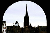 LOOKING OVER TO RAMSAY GARDEN, THE CAMERA OBSCURA AND THE SPIRE OF TOLBOOTH OF ST. JOHN (THE HUB) FROM THE ARCH OF THE CASTLE GATES, EDINBURGH. PIC: P.DODDS /SCOTTISH VIEWPOINT Tel: +44 (0) 131 622 71... Public, NMR ARCHITECTURE,THE HUB,SILHOUETTE,SCOTLAND,BUILDING,ARCHWAY