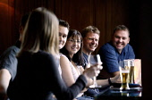 A GROUP OF FRIENDS ENJOY A DRINK IN THE NORTH BRIDGE BRASSERIE OF THE SCOTSMAN HOTEL, IN THE CITY CENTRE OF EDINBURGH. PIC: P.DODDS /SCOTTISH VIEWPOINT Tel: +44 (0) 131 622 7174   Fax: +44 (0) 131 622... Public, NMR CAFE CULTURE,WINE,SMILING,SMILE,SCOTLAND,PEOPLE,MODEL RELEASE,LAUGHING,LAUGH,LAGER,INTERIOR,DRINKING