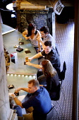 A GROUP OF FRIENDS SIT AT THE BAR AND ENJOY A DRINK IN THE NORTH BRIDGE BRASSERIE OF THE SCOTSMAN HOTEL, IN THE CITY CENTRE OF EDINBURGH. PIC: P.DODDS /SCOTTISH VIEWPOINT Tel: +44 (0) 131 622 7174   F... Public, NMR CAFE CULTURE,WINE,SCOTLAND,PEOPLE,MODEL RELEASE,LAGER,INTERIOR,DRINKING